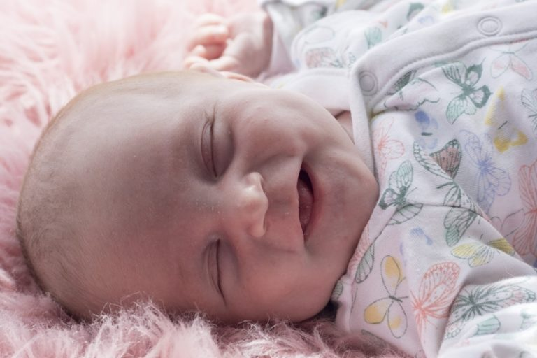 why do babies smile while sleeping